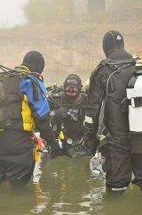 Divers Entering The Water
